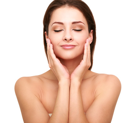 natural health: Beautiful spa woman with clean beauty skin touching her face with closed eyes  Beauty natural model Stock Photo