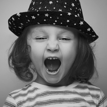 Shouting angry kid girl face  Closeup  Black and white portrait