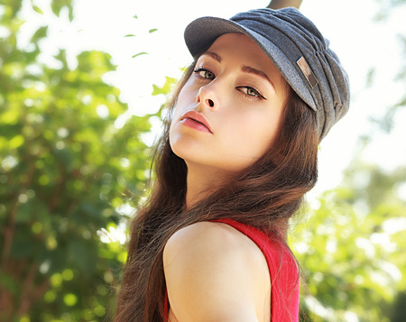 Sexy beautiful woman looking in hat outdoors summer background Stock Photo - 30520769