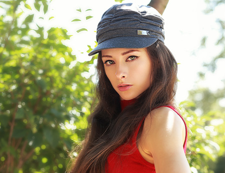 Beautiful long hair girl in hat looking sexy outdoors summer background Stock Photo - 30520765