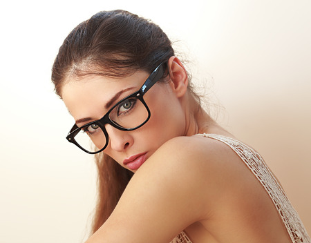 Sexy woman in trendy glasses looking on white background  Closeup Stock Photo