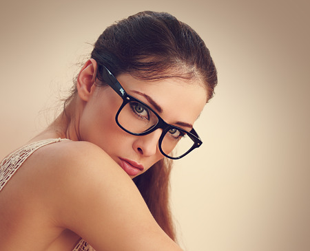 Sexy successful female model in fashion glasses looking  Closeup vintage portrait photo