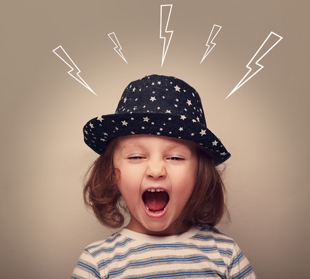 Shouting angry small kid with open mouth and lightnings above Standard-Bild