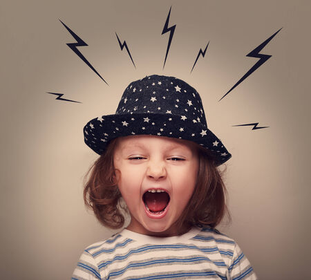 lightnings: Angry shouting kid with lightnings above the head on grey background