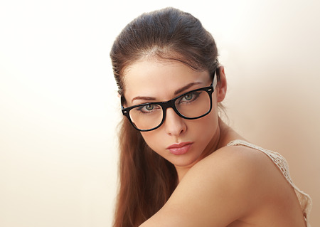 Beautiful sexy young woman in fashion glasses. Closeup photo