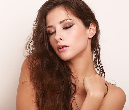 one eye closed: Beautiful long hair woman with closed makeup eyes Stock Photo