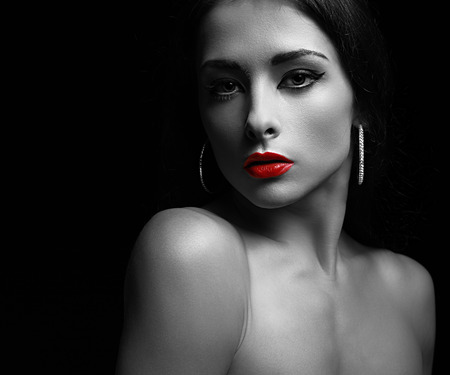 Sexy makeup woman with calm look. Art black and white portrait photo