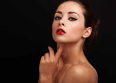Beautiful bright makeup female model looking sexy on black empty space background photo
