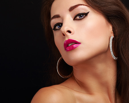 Bright sexy makeup with black arrows and pink lips. Closeup portrait photo