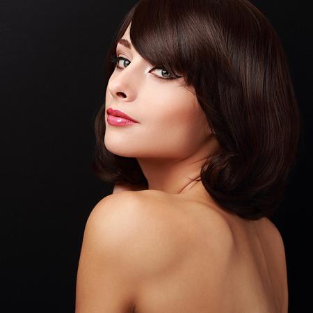 Happy makeup woman with short brown hair. Closeup portrait photo