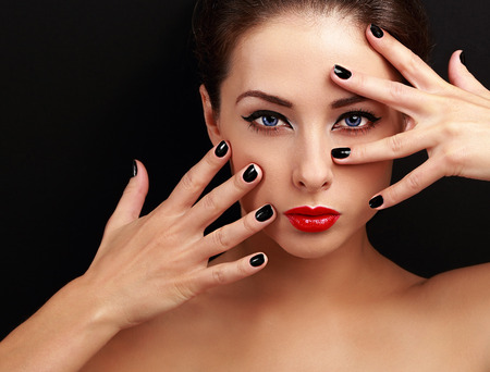 Beautiful woman with black nails looking sexy with empty copy space background. Closeup photo
