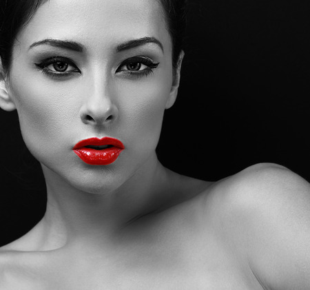 Sexy makeup woman with red lipstick. Black and white portrait. Closeup photo