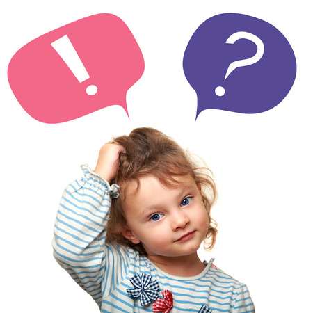 Thinking cute small kid girl with question and exclamation signs in bubbles isolated on white background Foto de archivo
