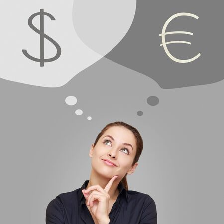 woman looking up: Thinking business woman looking up on dollar and euro currency on grey background Stock Photo