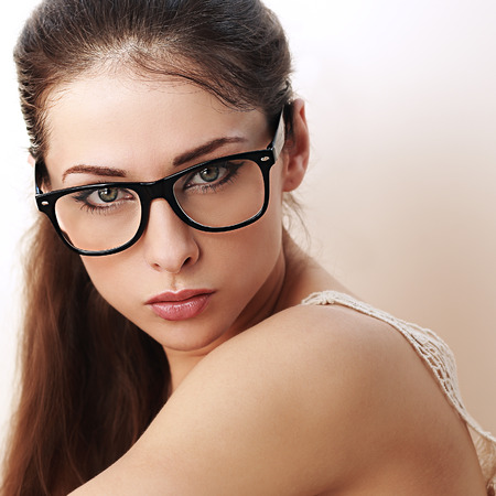 woman wearing glasses: Beautiful successful woman in black eyeglasses looking sexy. Closeup Stock Photo