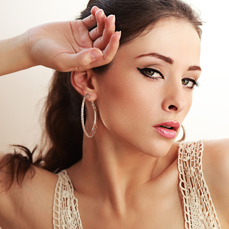 luxury liner: Sexy model with black eyeliner and pink lips looking. Closeup portrait