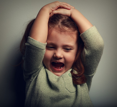 vintagel: Anger shouting kid holding head with open mouth. Closeup vintage portrait