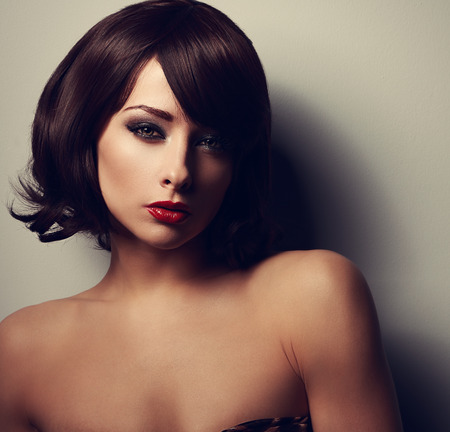 Beautiful short hair woman looking sexy with red lips. Closeup vintage portrait photo