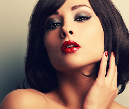 smokey: Bright makeup red lips woman with desire look and smokey eyes. Closeup vintage color portrait