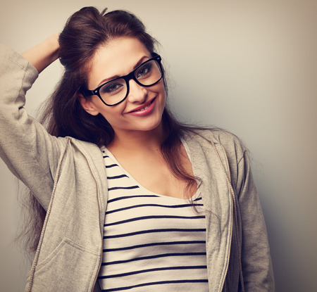 closeup portrait: Happy casual young woman in eye glasses looking. Vintage closeup portrait Stock Photo