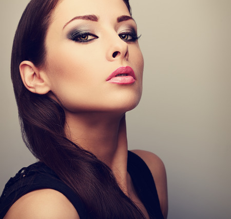eye care professional: Beautiful perfect makeup woman looking with smoky eyes. Color closeup portrait