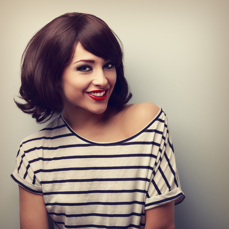short: Happy young woman with short hairstyle toothy smiling. Vintage closeup portrait
