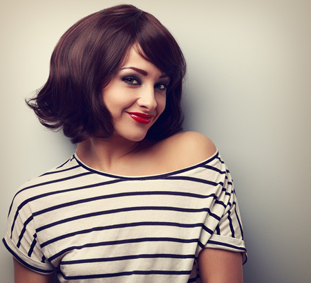 Short hair style makeup happy young woman. Vintage closeup portrait