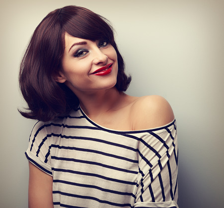Happy casual young smiling woman with short hairstyle looking. Vintage closeup portrait Stock Photo