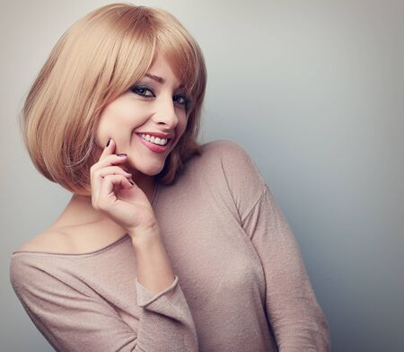 color hair: Happy blond woman with short hair style looking. Soft color toned closeup portrait