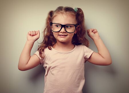 are strong: Strong happy successful girl showing muscular in glasses. Healthy child lifestyle. Closeup vintage portrait Stock Photo