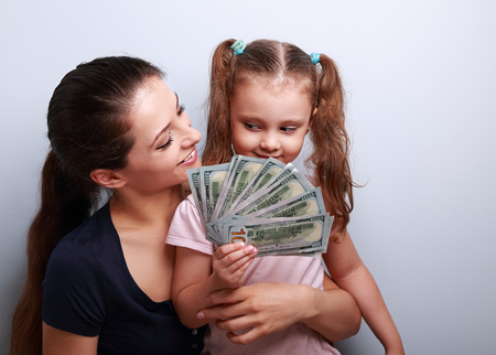 dollar: Happy casual family holding dollars and thinking how to spend the money. Portrait