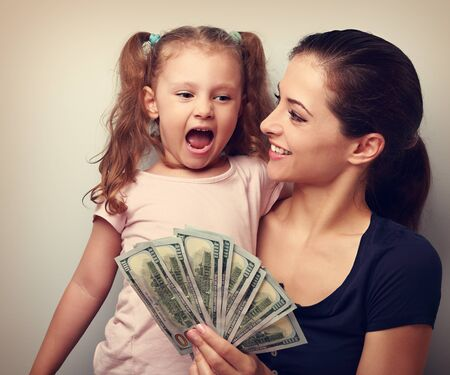 happy mom: Happy smiling family holding dollars and thinking how to spend the money. Vintage closeup portrait