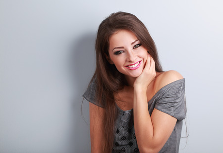 people laughing: Happy toothy laughing young woman with long hair in fashion blouse. Coseup portrait