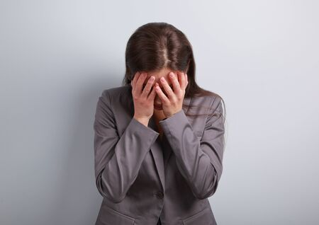 Business unhappy depression woman in suit covering the hand the face. It is fail