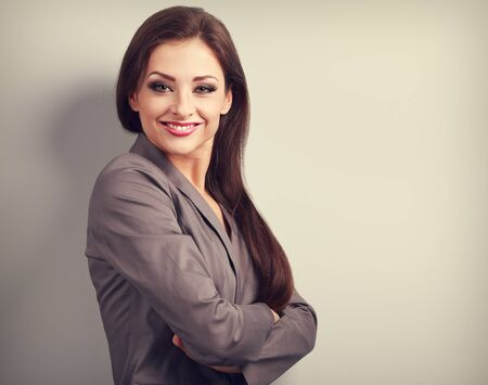 business lifestyle: Beautiful business woman in suit smiling on empty copy space background. Toned portrait Stock Photo