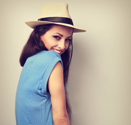 natural looking: Beautiful joying woman with straw hat looking with natural emotion. Vintage portrait