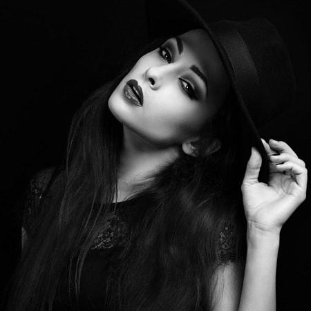 hot lips: Beautiful seductive bright makeup lady with hot lips posing in hat. Black and white closeup portrait
