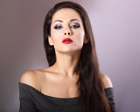 ceremonial make up: Beautiful woman with bright smokey makeup eyes and red lipstick. Perfect closeup make-up