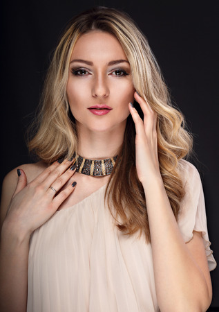 grey nails: Beautiful makeup fashion graceful woman with modern necklace and manicured nails looking on grey background