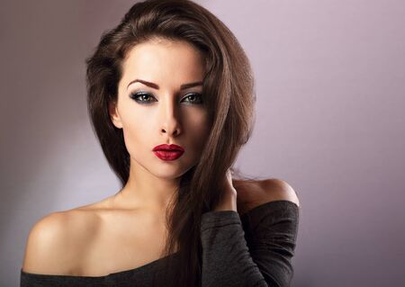 eye red: Beautiful makeup sexy woman with hot red lipstick and long eye lashes looking expression on blue background Stock Photo