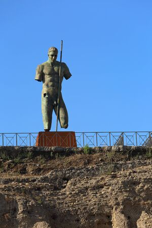 Ancient statue of warrior in Pompey dead town in Italy under blue sky background Stock Photo
