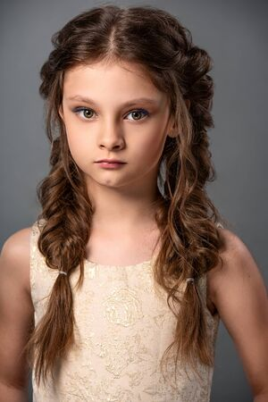 Beauty portrait of wedding clean makeup kid girl with stylish hairstyle. Closeup blonde girl in white dress. Boho braid. Wedding hairstyle. Closeup Stockfoto