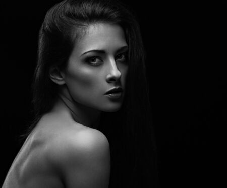Beautiful makeup sexy woman with long hair with wild look on black background with empty copy space. Closeup portrait. Art.Expression portrait. Vogue. Black and white Archivio Fotografico