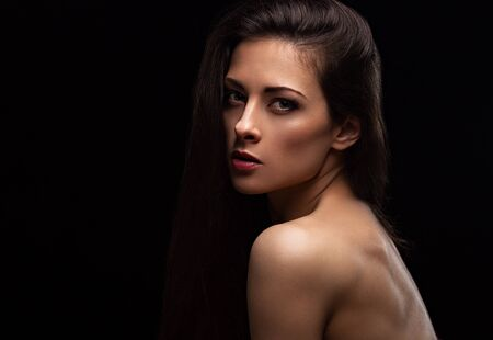 Beautiful makeup sexy woman with long hair with wild look on black background with empty copy space. Closeup portrait. Art.Expression portrait. Vogue. Archivio Fotografico