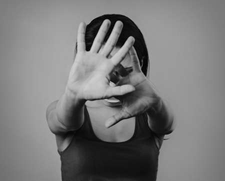 Angry woman protect against world virus, showing stop sign by palms. Help stop spreading corona virus pandemic infectious disease. In mask she stretching the hands for keeping distance avoid communication. Art. Black and white