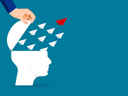 The human head was opened and the paper plane flew away. The concept of leadership and differentiation. business concept