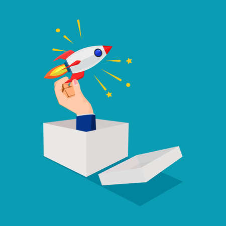 Hand holding a rocket out of a cardboard box. businessman thinking outside the box. business concept