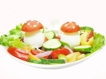 creative vegetable salad with mushrooms made of egg and tomato Stock Photo - 10980277