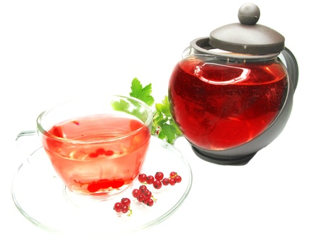 herbal tea with currant extract and berries photo