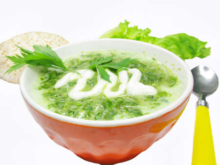 squash vegetable: green squash vegetable soup with sour cream and bread isolated Stock Photo
